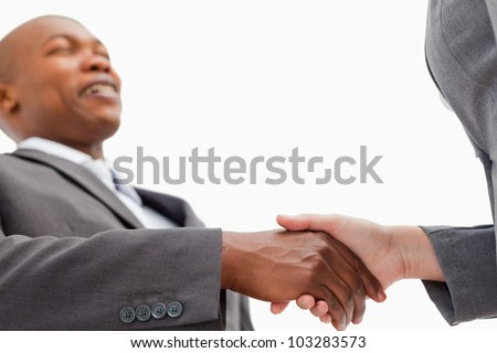 A businessman is shaking a hand