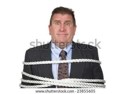 A businessman is tied up by his co-workers