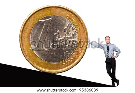 A businessman leaning against a Euro coin - stock photo