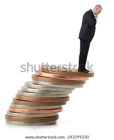 A businessman looking over the fiscal cliff. - stock photo