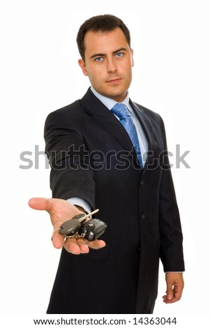A businessman offering a bunch of car keys and car alarm system