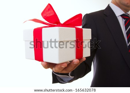 a businessman offering a gift to you (selective focus) - stock photo