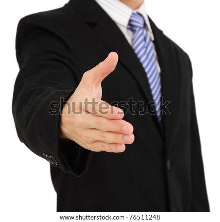 A businessman offering a handshake - stock photo