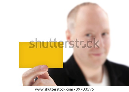 A businessman offering orange business card - stock photo