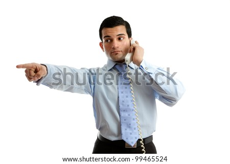 A businessman on the telephone pointing at your message or giving orders.  White background. - stock photo