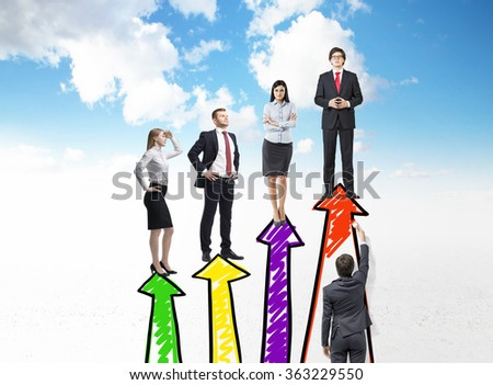 A businessman painting four vertical arrows of different colours that are arranged like a bar chart, four people standing on them. Blue sky with clouds at the background. Concept of career growth. - stock photo