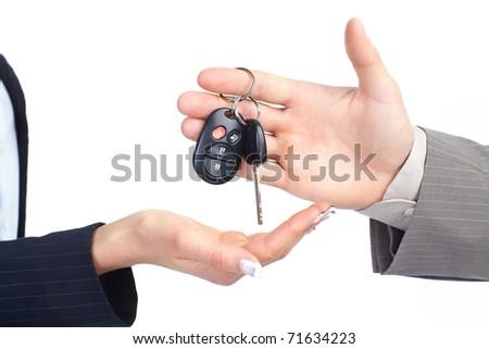 A businessman passing a car key - stock photo