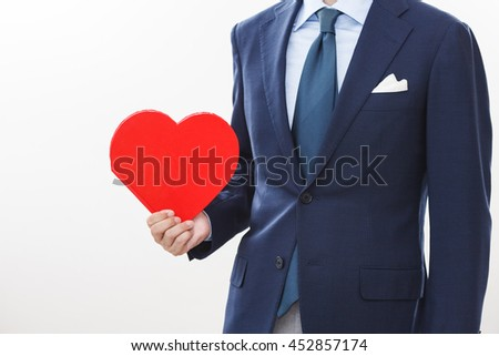 A businessman portrait with a heart