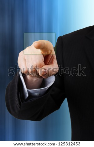 A businessman pressing a virtual button
