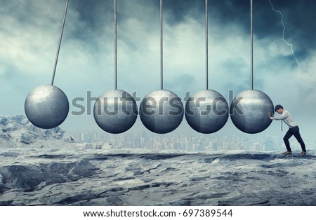 A businessman pushing at a hanging unmoving wrecking ball. Heavy burden. Business heavy tasks and problems concept.