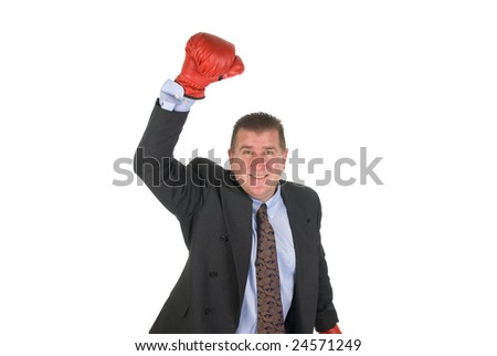 A businessman raises his arm in victory
