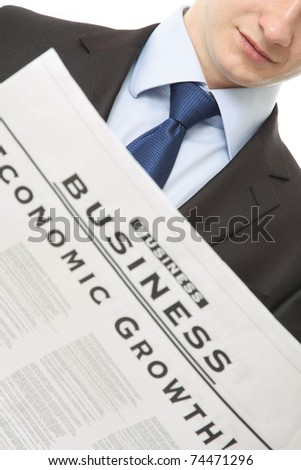 A businessman reading a newspaper - stock photo
