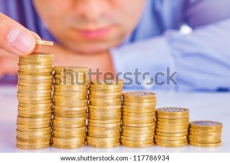 A Businessman rising coins - stock photo