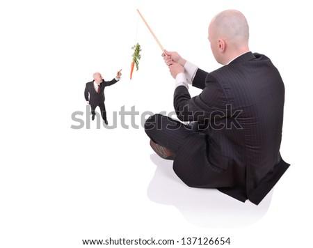 a businessman sat down fishing - stock photo