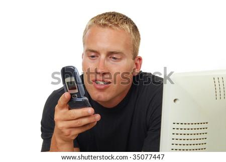A businessman sending a text message. - stock photo