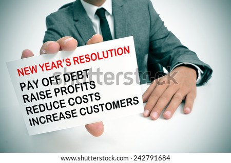 a businessman showing a list of new years resolutions for his business - stock photo