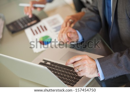 A businessman showing things on his laptop - stock photo
