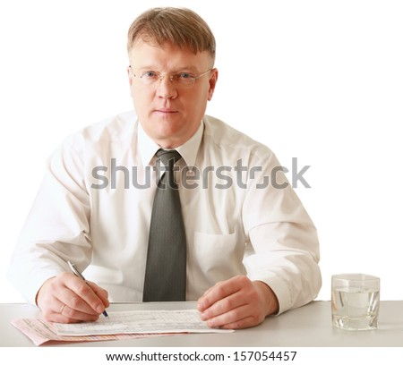 A businessman sitting on the desk, isolated on white background