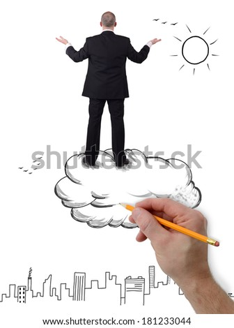 A businessman standing on a cloud arms outstretched overlooking a city - stock photo