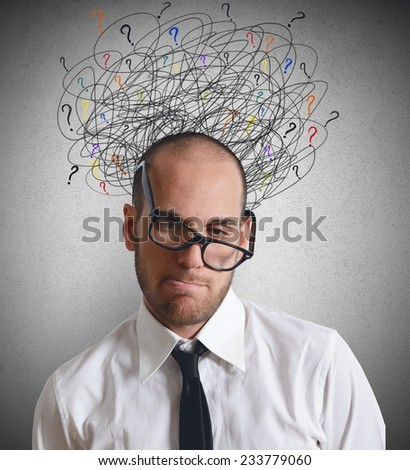A businessman stressed and confused by job - stock photo