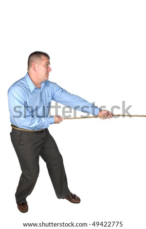 A businessman struggles during a bout of tug of war with a co-worker to resolve a conflict, decision or power struggle.