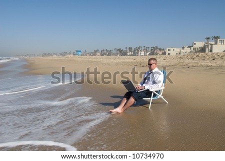 A businessman takes his office to the beach.