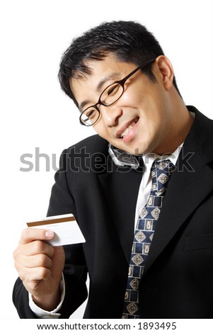 A businessman talking on the phone while holding credit card