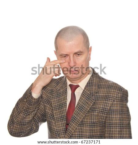 A businessman touching his eye. Isolated on white. Body language. Manifest of telling untruth. - stock photo