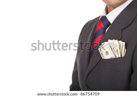 A businessman wearing a suit and tie with cash sticking out of his pocket