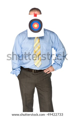 A businessman with a bulls eye taped on his forehead - stock photo