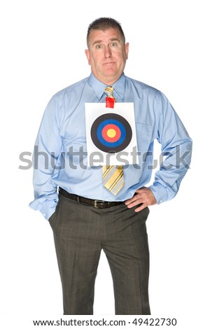 A businessman with a bulls eye target taped to his dress shirt.