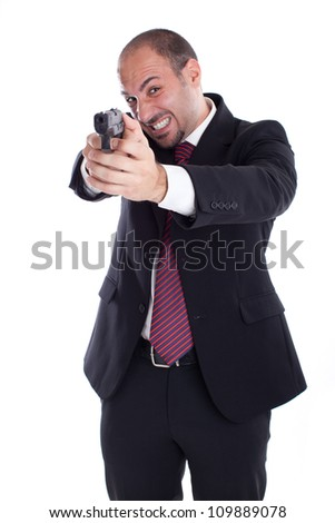 a businessman with a gun aiming at you! - stock photo