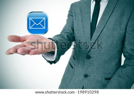 a businessman with a message icon in his hand depicting the instant messaging apps - stock photo