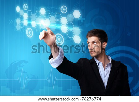 A businessman working on modern technology - stock photo