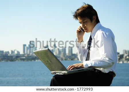 A businessman working outdoor at a park