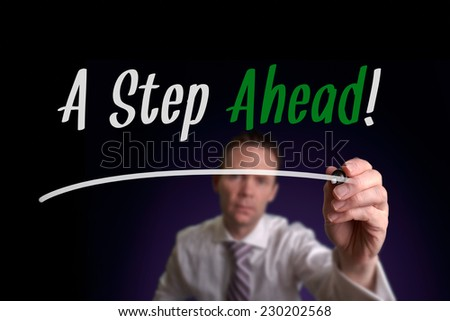 A businessman writing a Step Ahead on a screen. Business Concept. - stock photo