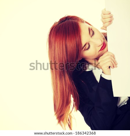A businesswoman behind the white board. - stock photo