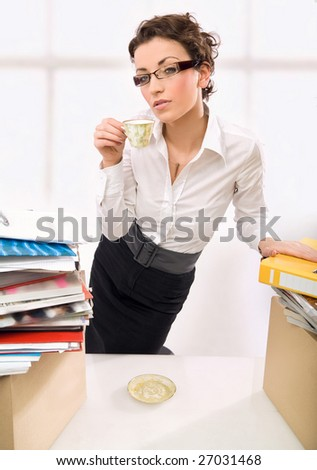 A businesswoman drinking coffee, thinking - stock photo