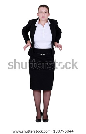 A businesswoman feeling tight. - stock photo