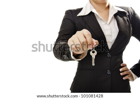 a businesswoman holding a key