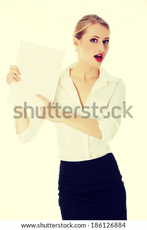 A businesswoman holding white board. - stock photo