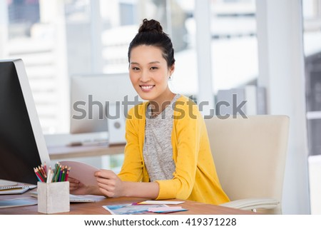 A businesswoman is working in her office