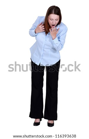 A businesswoman looking down. - stock photo