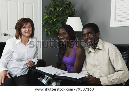 A Businesswoman Meeting With A Couple - stock photo