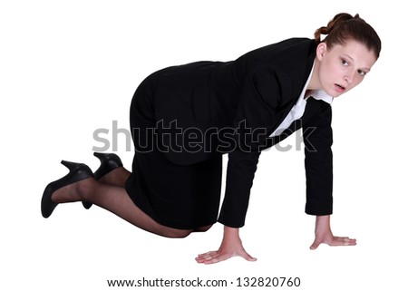 A businesswoman on all fours.