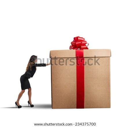 A businesswoman pushing a big Christmas gift - stock photo