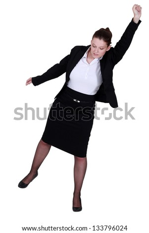 A businesswoman raising her fist to the sky. - stock photo