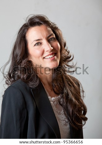 A businesswoman smiling at the camera