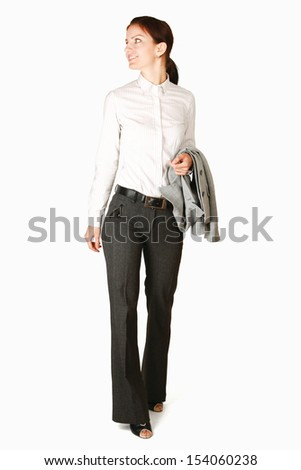 A businesswoman standing with a jacket , isolated on white background - stock photo