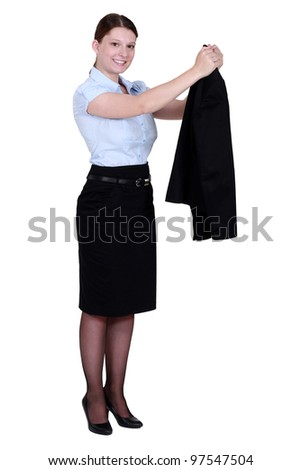 A businesswoman taking off her jacket. - stock photo